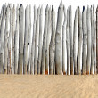 Fence on sand isolated — Stock Photo