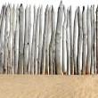 Stock Photo: Fence on sand isolated