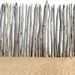 Fence on sand isolated — Stock Photo