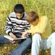 Two teenagers with a book — Stock Photo