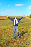 Young man in the field — Stock Photo