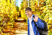 Young man wave goodbye — Stock Photo