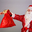 Stock Photo: Santa gives gifts