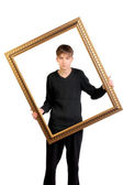 Teenager with frame — Stock Photo
