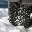 Car wheel in snow — Stock Photo
