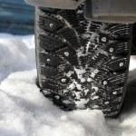 Car wheel in snow — Stock Photo