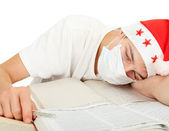 Diseased student in santa hat — Stock Photo