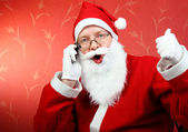 Happy santa claus with phone — Stock Photo
