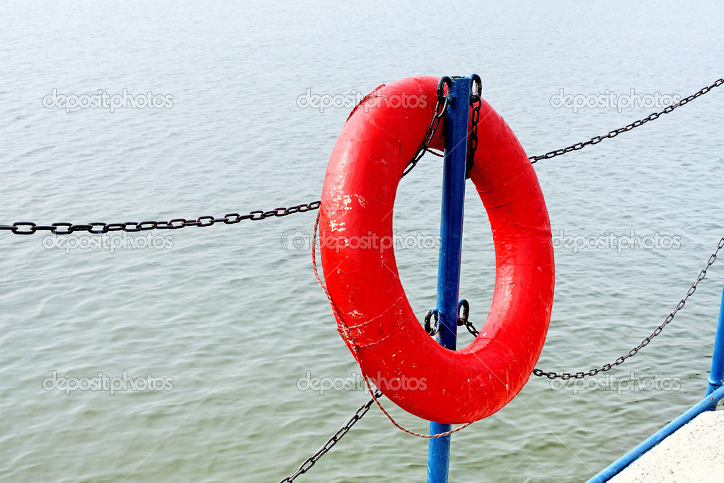 Ring-buoy on the Pier on the Water background  Stock Photo #14892021