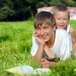 Teenager And Kid In The Park — Stock Photo