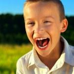 Boy Screaming Outdoor — Stock Photo #20694129
