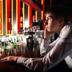 Sad Young Man at the Bar — Stock Photo #21680243