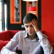 Sad Young Man With Phone — Stock Photo #21680261