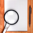 Stock Photo: Writing Pad And Loupe