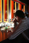 Sad Young Man at the Bar — Stock Photo