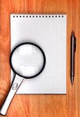 Writing Pad And Loupe — Stock Photo
