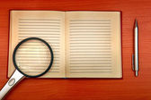 Old Writing Pad And Loupe — Stock Photo