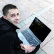 Man With Laptop Outdoor — Stock Photo #22452659