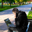 Man With Laptop At The Park - Stock Photo