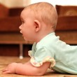 Surprised Baby on the Floor — Stock Photo