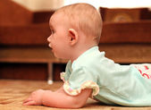 Surprised Baby on the Floor — Стоковое фото