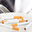 Plate with Cigarettes — Stock Photo