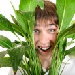 Surprised Young Man in Leaves - Stock Photo