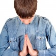 Praying Man in Handcuffs - Stock Photo