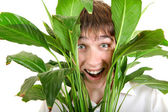 Surprised Young Man in Leaves — Stock Photo
