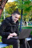Happy Man with Laptop Outdoor — Stock Photo