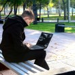 Man Working on Laptop at the Park — Stock Photo