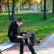 Man Working on Laptop at the Park — Stock Photo #30960719