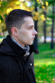 Man Portrait at the Autumn Park — Stock Photo