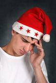 θλιβερή έφηβος με καπέλο αϊ-βασίλη — Φωτογραφία Αρχείου