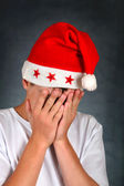 Sad Teenager in Santas Hat — Stock Photo