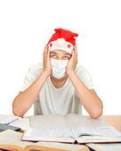 άρρωστος φοιτητής με καπέλο αϊ-βασίλη — Φωτογραφία Αρχείου