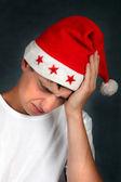 Teenager in Santa Hat feels Headache — Stock Photo
