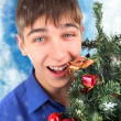 Happy Teenager with Christmas Tree — Stock Photo