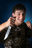 Angry Teenager with Knife — Stock Photo
