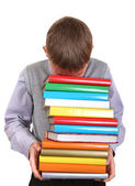 Boy holding Pile of the Books — Stock Photo