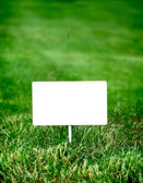 Notice Board on the Grass — Stock Photo
