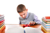 Schoolboy plays with a Toy — Stock Photo