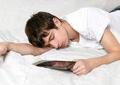 Young Man sleeps with Tablet Computer — Stock Photo