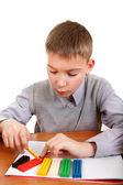 Boy playing with Plasticine — Foto de Stock