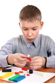Boy playing with Plasticine — Stock Photo