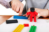 Kid playing with Plasticine Closeup — Stock Photo