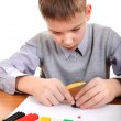 Stock Photo: Boy playing with Play Dough