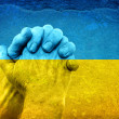 Hands on Ukrainian Flag — Stock Photo
