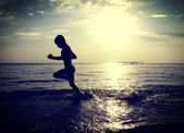 Kid running in the Water — Stock Photo