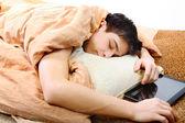 Teenager sleeps with Tablet Computer — Stock Photo